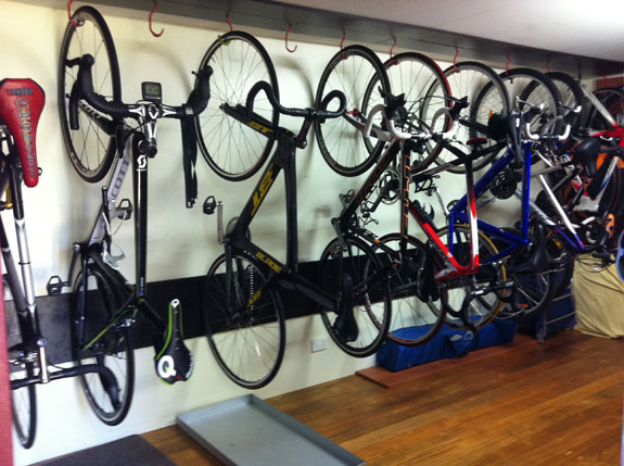 """""""Inside the shed that houses the family bikes. (From left to right): fixie (mine), Scott (mine), BT (mine), Fuji (brother's, my old bike), Ridley (dad's, my old bike), 'megabike' (other brother's, my first race bike, was originally dad's), misc mountain bikes & CKT track bike (dad's, my old bike)."""""""