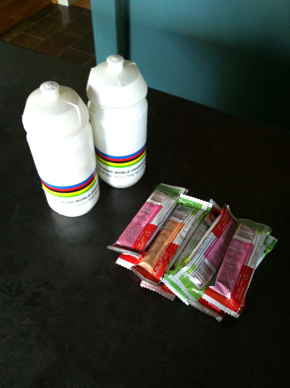 """""""Food and water for a four hour ride. Depending on the intensity and temperature I'll eat between 5-8 muesli bars while on the road and drink at least four bidons. I usually have a Formula 1 Muesli Bar every 30mins and one bidon (water) every hour depending on the temperature. I've learnt that it's always better to have too much food/water than not enough!"""""""