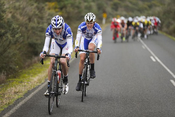 """""""Shake and bake! Teammate Tom Hamilton and I having a crack up a short climb late in Stage 08. Another wet and windy day."""""""
