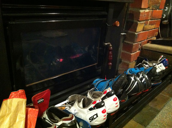 """""""All the shoes drying on the rack after a rain-soaked stage."""""""