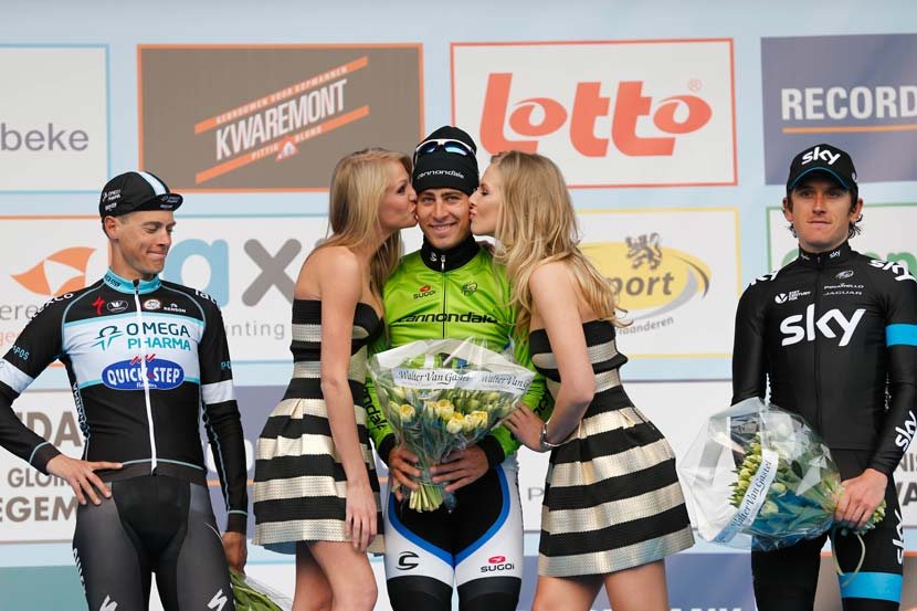 Almost one year on... The 2013 Ronde van Vlaanderen was a great race but much of the commentary afterwards related to Peter Sagan's antics on the podium. A year later, he seems to realise that better behaviour is required and, on the podium of the GP E3, he offers a cheeky grin while keeping his hands to himself around the podium girls. Niki Terpstra, however... well, the picture tells a story. Photo: Yuzuru Sunada