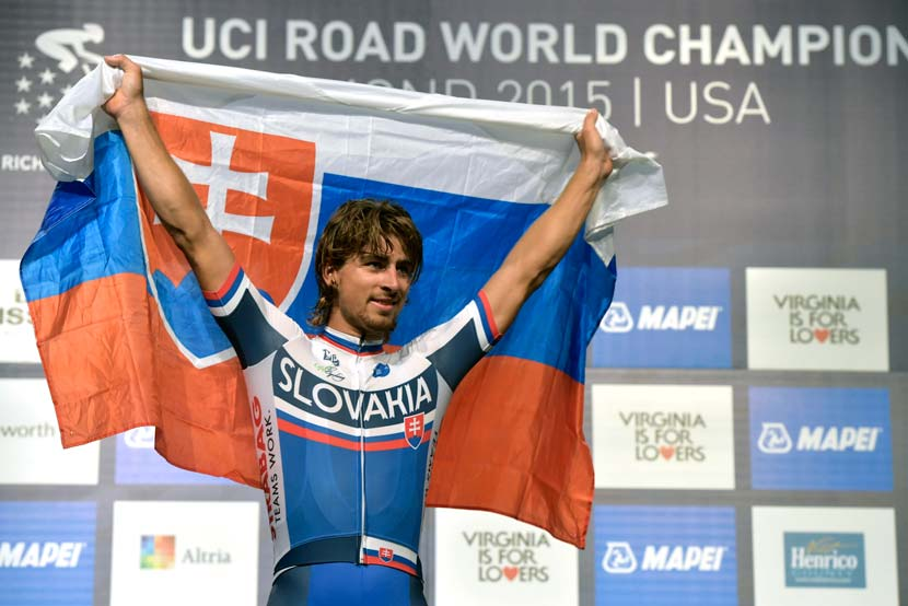 On the podium moments before receiving the rainbow jersey. Photo: Graham Watson