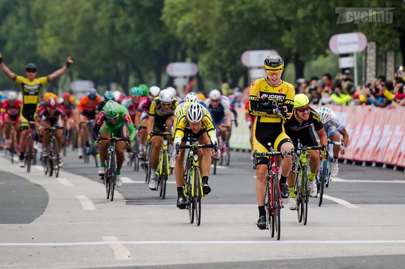 Jesse Kerrison offers a different kind of victory salute on day one of the Tour of Taihu Lake.