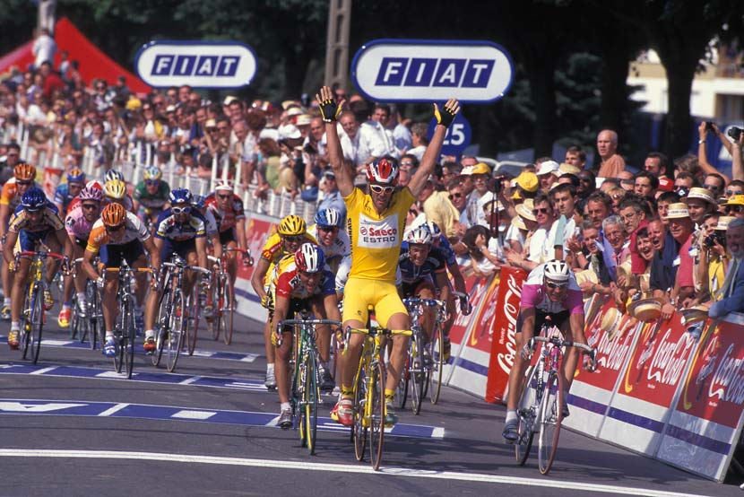The yellow combo – Mario Cipollini wins stage two of the 1997 Tour in the yellow jersey... and yellow knicks, yellow helmet, yellow gloves... and on a yellow bike.  Photo: Yuzuru Sunada