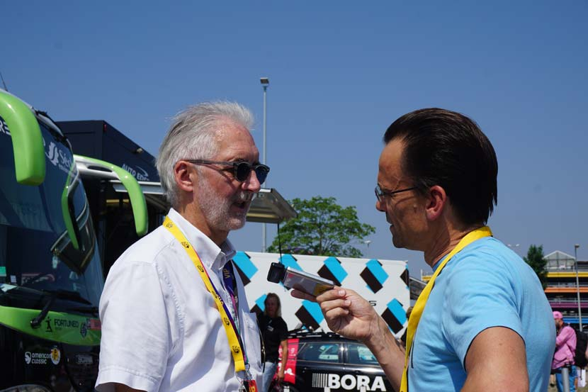 Brian Cookson speaks to Rob Arnold about the Lars Boom case on the morning of the opening stage of the 2015 Tour de France. Photo: Jack Lynch.