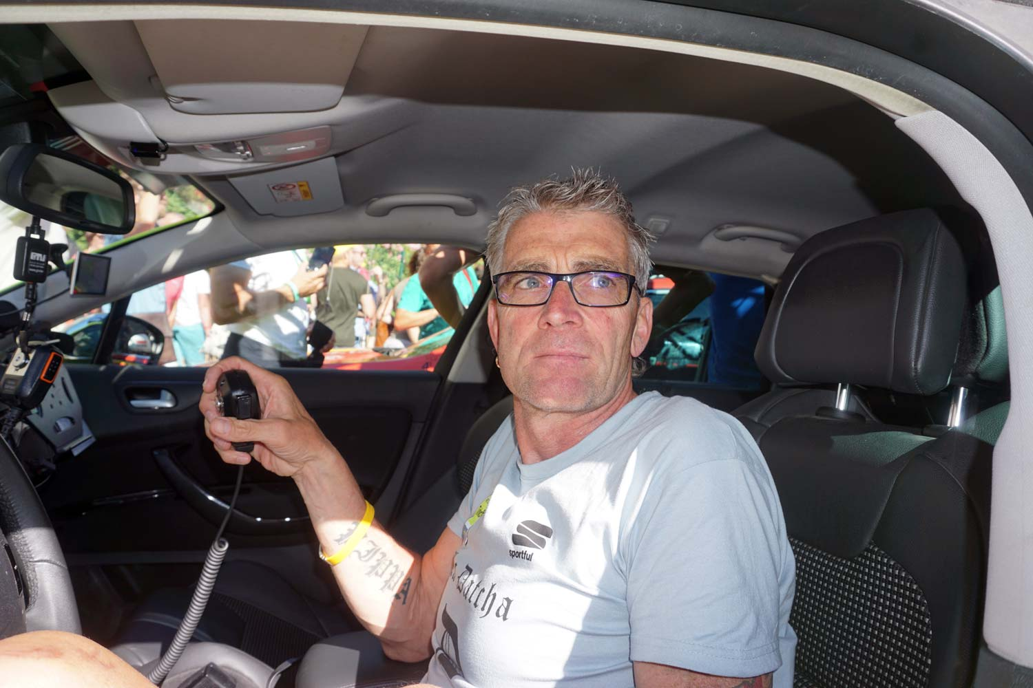 Sean Yates at the wheel of the Tinkoff team car in Montpellier after stage 11. Photo: Rob Arnold