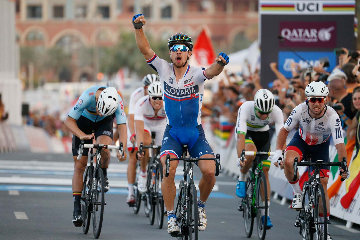 A second title... Peter Sagan celebrates while both Tom Boonen and Mark Cavendish show signs of frustration at having missed out on winning a championship for a second time. Photo: Yuzuru Sunada